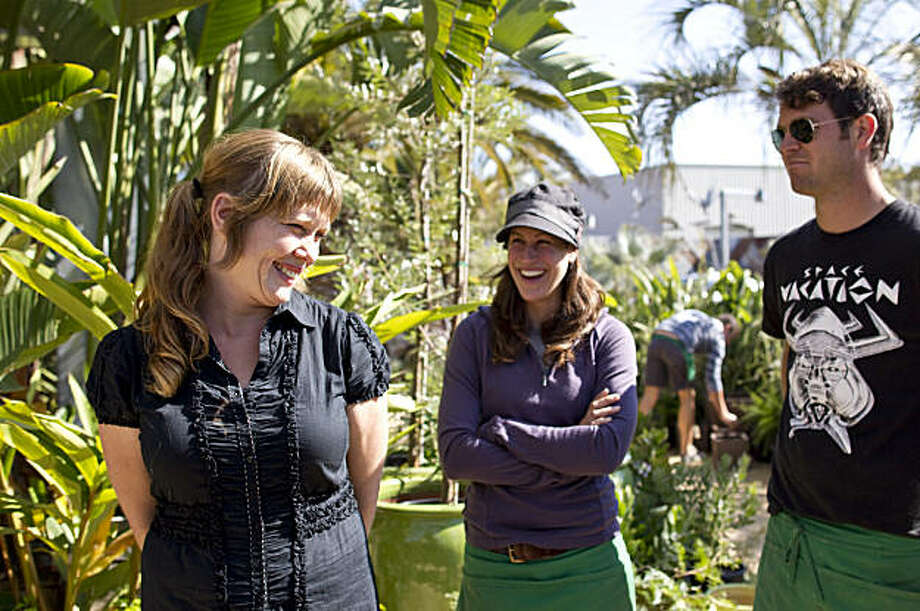 Flora Grubb, Sydney Nahay and Jared Sussman (left to right) talk during a staff meeting at Flora Grubb Gardens in San Francisco, Calif., on Thursday, September 30, 2010.  Last year the business was in danger, but the nursery received help from Pacific Community Ventures, which helps small businesses in lower-income communities. Photo: Laura Morton, Special To The Chronicle
