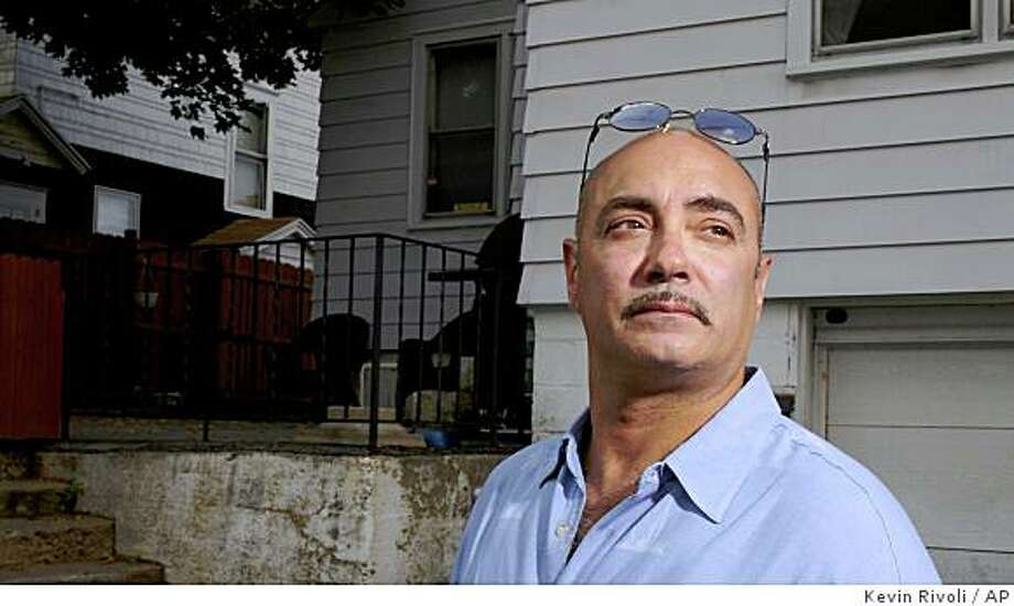 Tony Messina poses for a portrait outside his home in Syracuse, N.Y., Monday, July 7, 2008. Messina had made some enemies on a party line he frequented to flirt with women. Some guys disliked him and his friends out of jealousy, he says, started swatting him. (AP Photo/Kevin Rivoli) Photo: Kevin Rivoli, AP