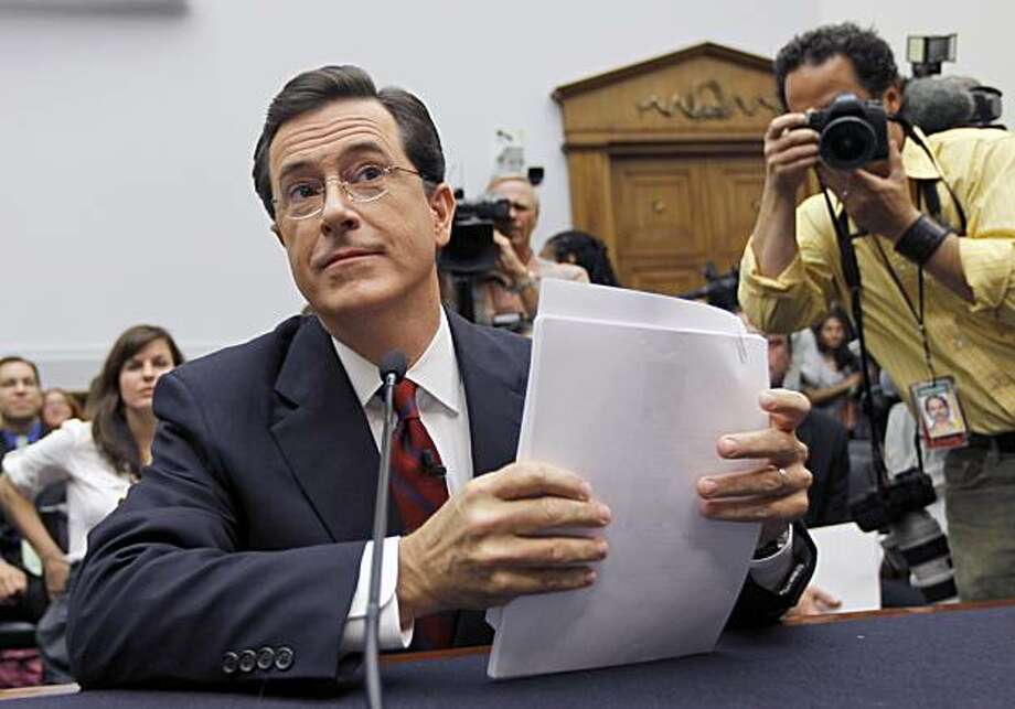 Comedian Stephen Colbert, host of the Colbert Report, prepares to testify on Capitol Hill in Washington, Friday, Sept. 24, 2010, before the House Immigration, Citizenship, Refugees, Border Security and International Law subcommittee hearing on Protecting America's Harvest. Photo: Alex Brandon, AP