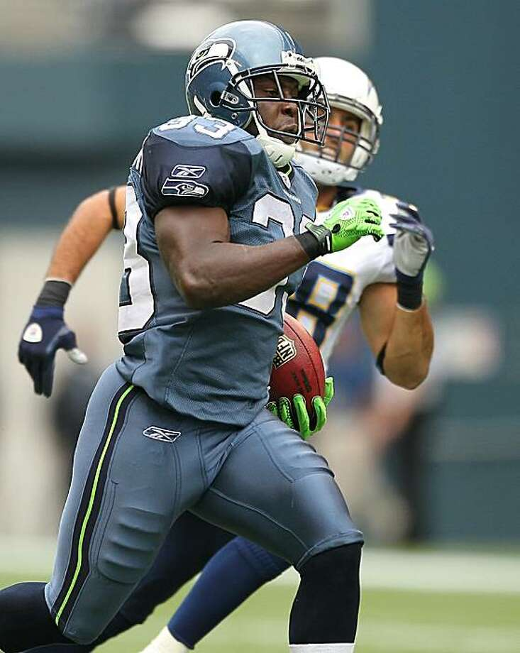 SEATTLE - SEPTEMBER 26:  Kick returner Leon Washington #33 of the Seattle Seahawks rushes for a 101 yard kickoff return for a touchdown in the third quarter against Steve Gregory #28 of the San Diego Chargers at Qwest Field on September 26, 2010 in Seattle, Washington. The Seahawks defeated the Chargers 27-20. Photo: Otto Greule Jr, Getty Images