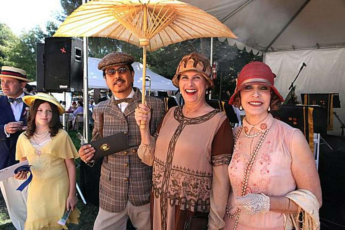 Best dressed lady Martha Chilvers (in brown) with best dressed man and best dressed child and judge Cicely Hansen at Gatsby Summer Afternoon Sept. 12.