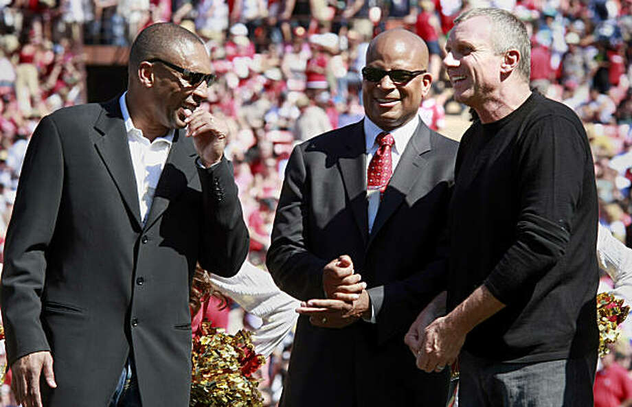 Former 49ers Roger Craig (left) Ronnie Lott and Joe Montana enjoy a light moment during the halftime ceremony honoring Eddie DeBartolo Jr. on Sunday. Photo: Brant Ward, The Chronicle