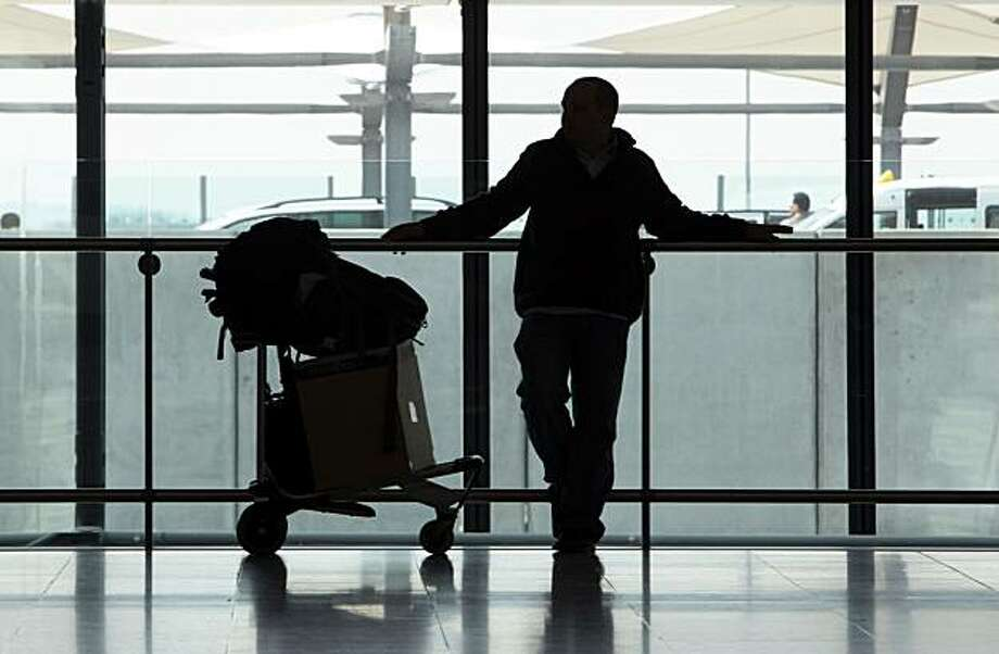 A passenger waits for information at Terminal 5 at Heathrow Airport in London, U.K., on Thursday, April 15, 2010. Airports in the U.K. and northern Europe shut down as a cloud of volcanic ash swept south from an eruption in Iceland, disrupting travelfor thousands of people booked on flights with British Airways Plc and other carriers. Photographer: Chris Ratcliffe/Bloomberg Photo: Chris Ratcliffe, Bloomberg News