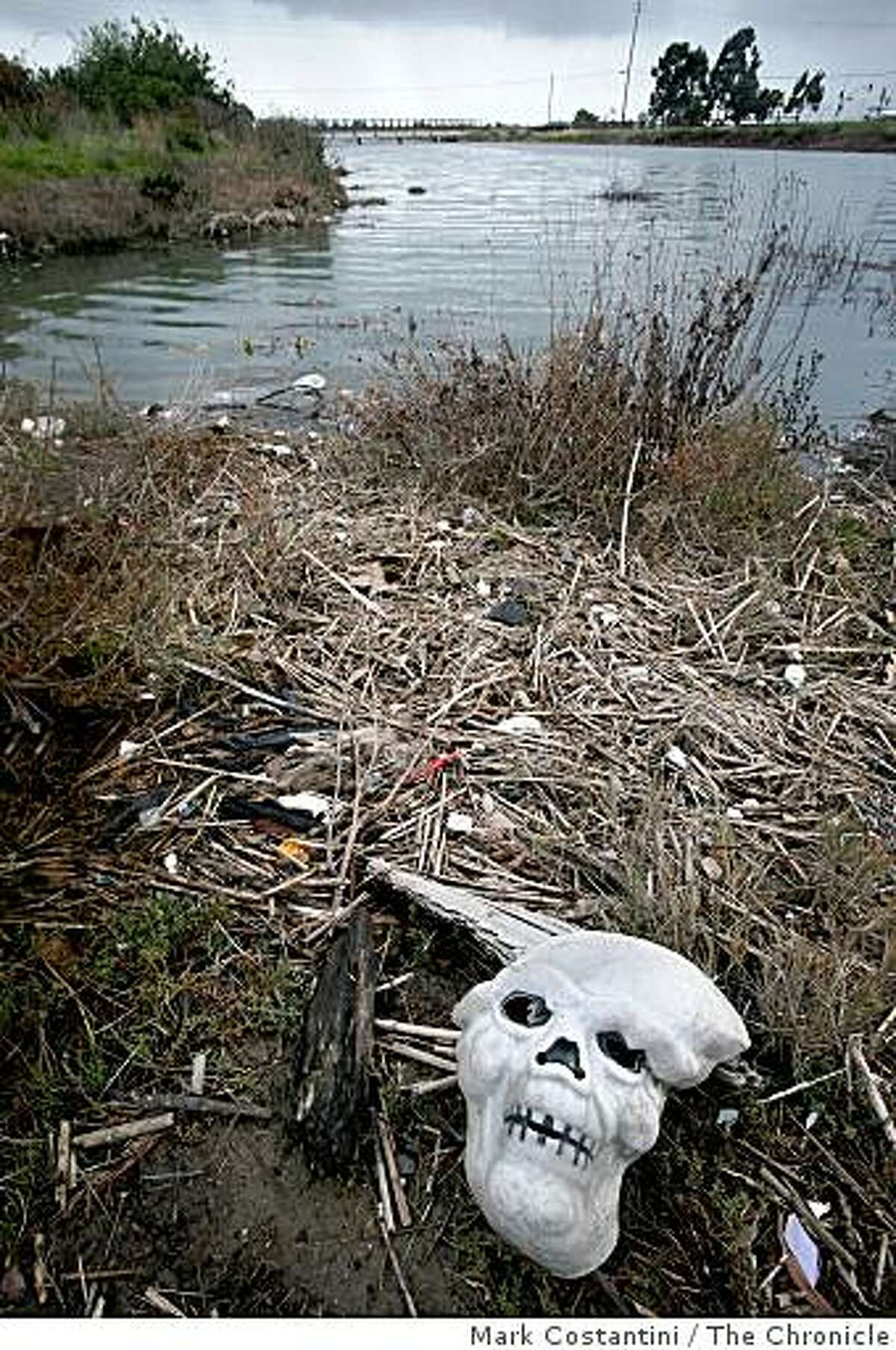 Garbage litters the waterway as water from Damon Sloug flows to the Bay in Oakland, Calif. on Wednesday, February 11, 2009.