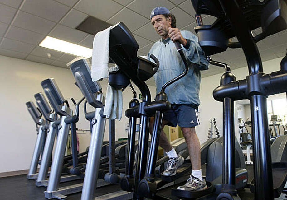 Jim Malick from San Francisco works out using a heart rate device built into the machine at Stonestown Family YMCA in San Francisco, Calif., Friday, Sept. 24, 2010.  For years people have used the heart rate charts at the gym to tell them how hard they're working (or not working), but those charts aren't totally accurate for most people, and even more so for women, according to studies. Sports doctors and physical trainers talk about how people should effectively use heart rate information when they exercise -- or if it's a good idea to use that information at all. The answer depends on who you are, and what you're trying to accomplish. Photo: Lance Iversen, The Chronicle