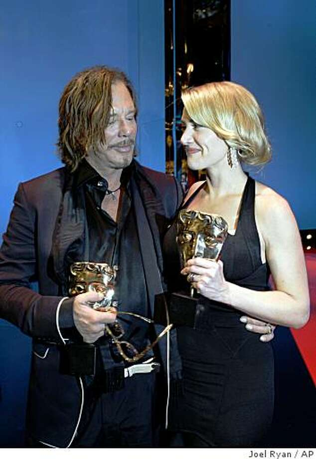 US actor Mickey Rourke, left, with his Best Actor award for his role in 'The Wrestler' and British actress Kate Winslet with her award for Best Actress for her role in the film 'The Reader' at the British Academy Film Awards 2009 at The Royal Opera House in London, England, Sunday, Feb. 8, 2009. Photo: Joel Ryan, AP