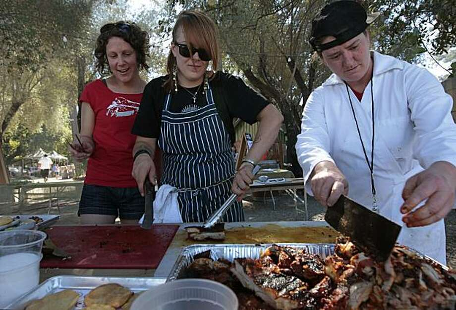 Butchers from San Francisco restaurant Avedano's , Melanie Eisemann, Tia Harrison and Angela Wilson prepare lamb tostadas to share, during the Primal event, where chefs and butchers from around the country celebrate the art of animal butchery and roasted meats, on Saturday Sept. 25, 2010 in St. Helena, Calif. Photo: Michael Macor, The Chronicle