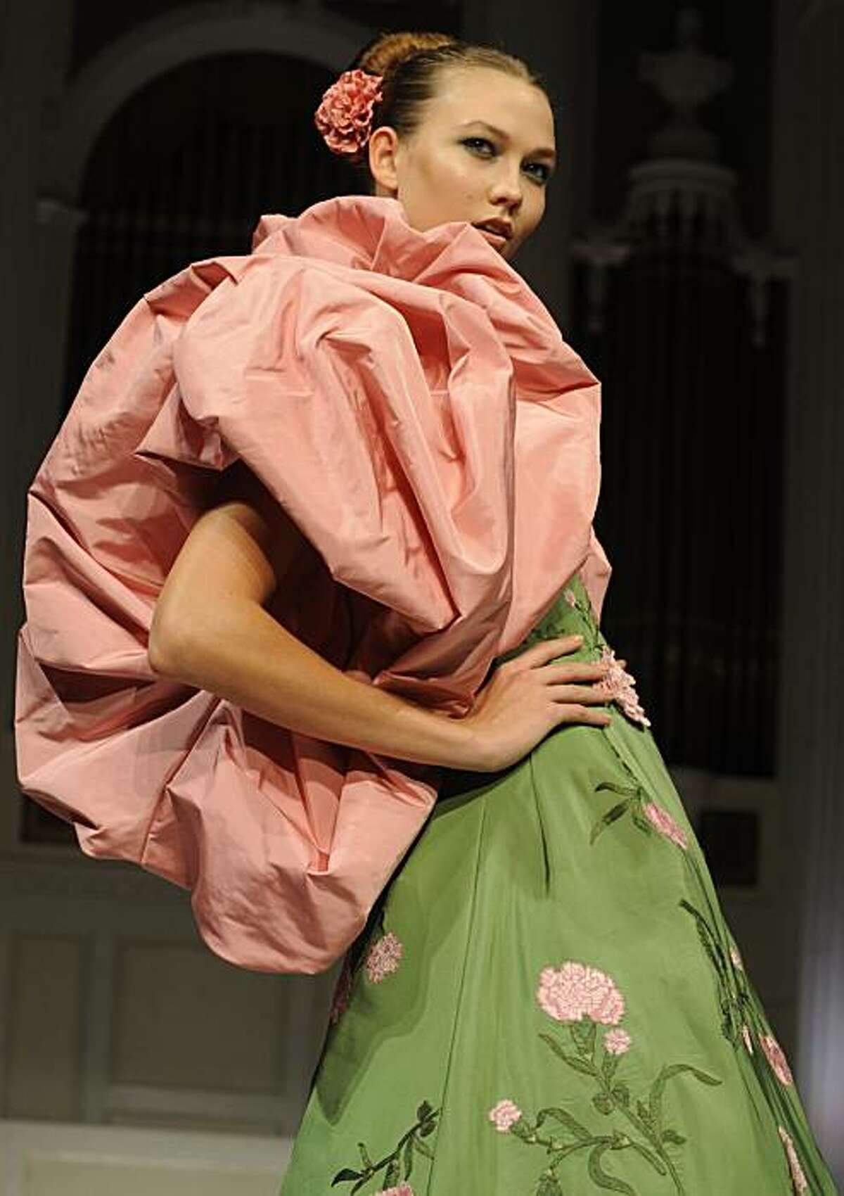The Oscar de la Renta spring 2011 collection is modeled during Fashion Week, Thursday Sept. 16, 2010, in New York.