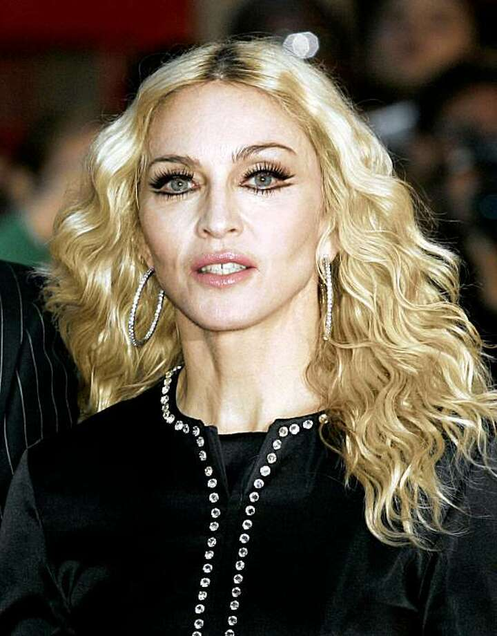 """** FILE ** In this Sept. 1, 2008 file photo, Madonna arrives for the world premiere of his film """"Rock n Rolla"""" in London.  (AP Photo/Sang Tan, file) Photo: Sang Tan, AP"""