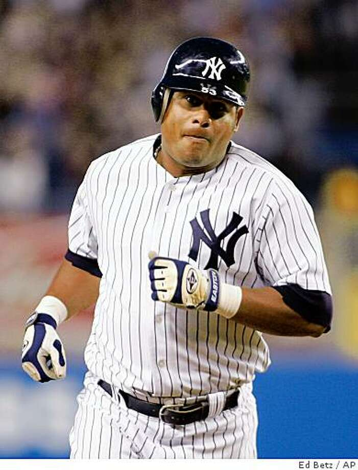 New York Yankees Bobby Abreu heads toward third base after hitting a three run home run against the Tampa Bay Devil Rays during the first inning of their baseball game, Tuesday, Sept. 12, 2006, at Yankee Stadium in New York. (AP Photo/Ed Betz) Photo: Ed Betz, AP