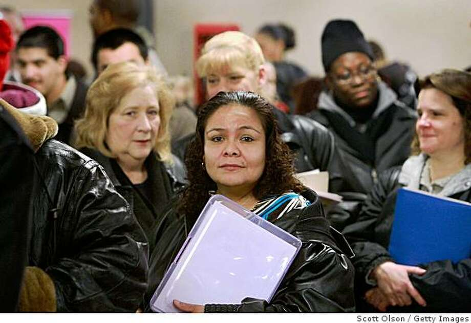 CHICAGO - FEBRUARY 05:  Job seekers wait in line to speak with prospective employers at a job fair February 5, 2009 in Chicago, Illinois. The number of U.S. workers filing new claims for unemployment benefits last week jumped to a 26-year high.  (Photo by Scott Olson/Getty Images) Photo: Scott Olson, Getty Images