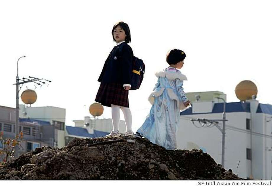 "So Yong Kim's film ""Treeless Mountain"" is the closing night film of the 2009 San Francisco International Asian American Film Festival, which runs March 12-22. From left: Hee Yeon Kim as Jin, Song Hee as Bin. Photo: Handout, SF Int'l Asian Am Film Festival"