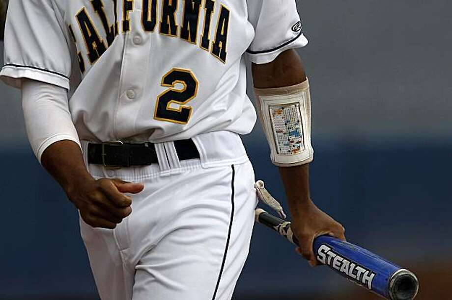 Brian Guinn, has a list of plays attached to his arm during a game against UC Davis on Tuesday May, 5, 2009 in Berkeley, Calif. The team uses a numeric system to deliver plays to the batters, which corresponds to the list. Photo: Michael Macor, The Chronicle