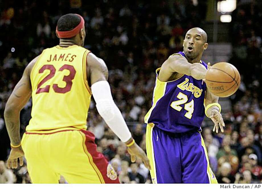 Los Angeles Lakers' Kobe Bryant (24) fires a pass around Cleveland Cavaliers' LeBron James (23) during the third quarter of an NBA basketball game Sunday, Feb. 8, 2009, in Cleveland. The Lakers beat the Cavaliers 101-91. (AP Photo/Mark Duncan) Photo: Mark Duncan, AP