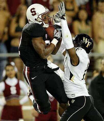 Stanford's Chris Owusu, (81) pulls in a 38 yard touchdown pass in the first quarter, defended by A.J. marshal, (17), as the Stanford Cardinal takes on Wake Forest in college football action at Stanford Stadium in Palo Alto, Ca. on Saturday Sept. 18, 2010. Photo: Michael Macor, The Chronicle