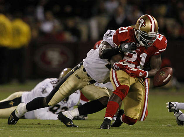 Frank Gore loses his grasp but quickly recovers the ball on a run play in the fourth quarter of the San Francisco 49ers and New Orleans Saints game at Candlestick Park in San Francisco on Monday. Photo: Paul Chinn, The Chronicle