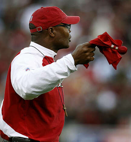 Head coach Mike Singletary throws the red challenge flag during the first half of the San Francisco 49ers and New Orleans Saints game at Candlestick Park in San Francisco on Monday. Photo: Paul Chinn, The Chronicle