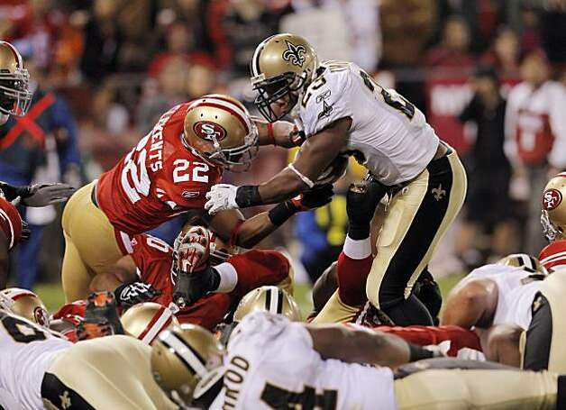 The 49ers' Nate Clements stops Saints running back Pierre Thomas on a goal line stand in the fourth quarter Monday, forcing the Saints to kick a field goal. Photo: Carlos Avila Gonzalez, The Chronicle