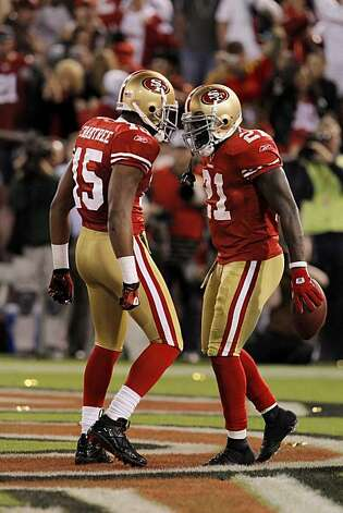 Michael Crabtree, left, and Frank Gore, right, celebrate Gore's fourth quarter touchdown Monday in San Francisco. Photo: Carlos Avila Gonzalez, The Chronicle