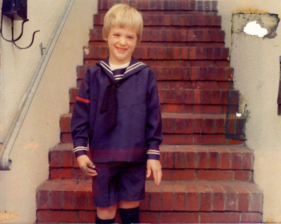 Gavin Newsom stands on the steps of his family's Marina District home  in San Francisco, Calif., in 1974. He is wearing the uniform from Notre Dame des Victoires School. Photo: Newsom Family Photo