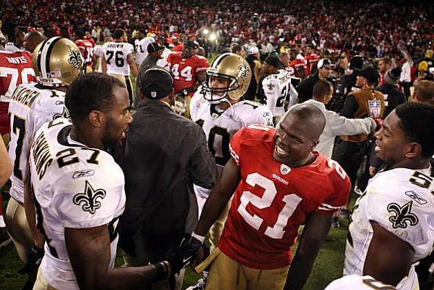 49ers running back Frank Gore congratulates Saints players Malcolm Jenkins, left, and Johathan Vilma after the game Monday in San Francisco. Photo: Carlos Avila Gonzalez, The Chronicle