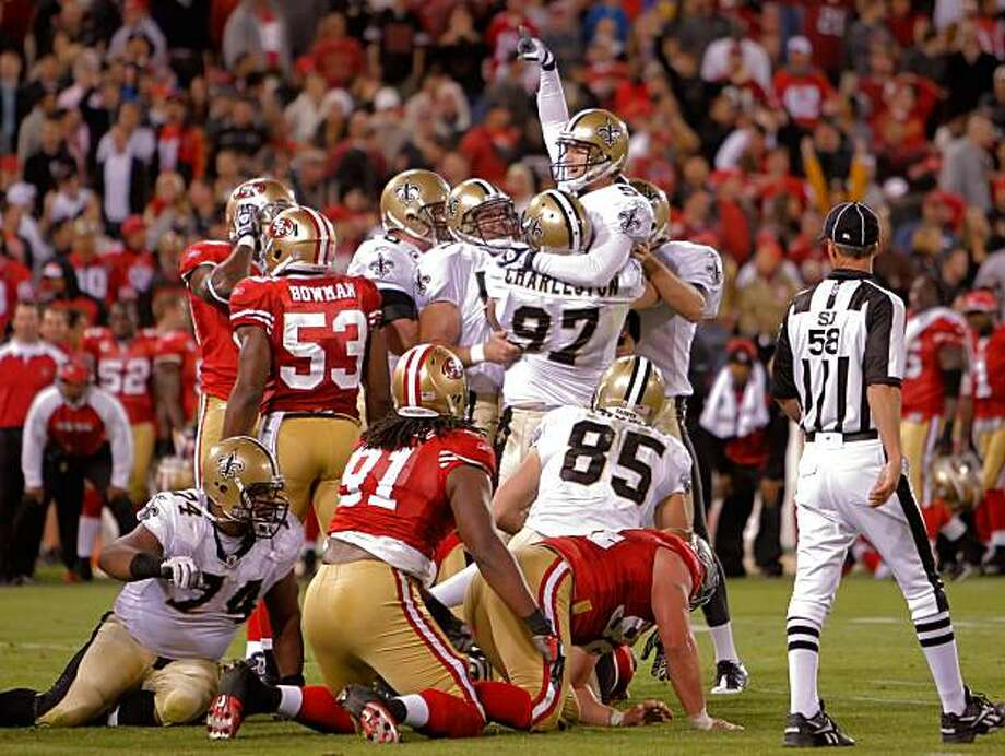 Saints kicker Garrett Hartley is held high as they celebrate his last-second, game-winning field goal against the 49ers on Monday. Photo: Carlos Avila Gonzalez, The Chronicle