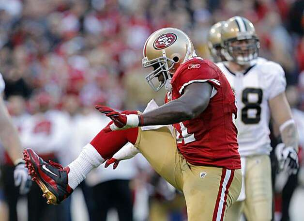 Takeo Spikes celebrates stopping Pierre Thomas in the second quarter for no gain Monday in San Francisco. Photo: Carlos Avila Gonzalez, The Chronicle