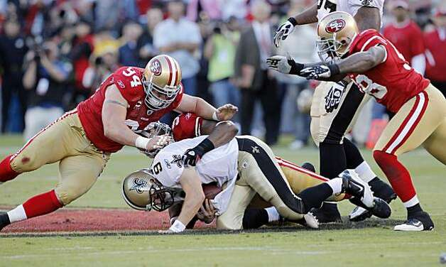Drew Brees is sacked by Ahmad Brooks in the first quarter Monday in San Francisco. Photo: Carlos Avila Gonzalez, The Chronicle