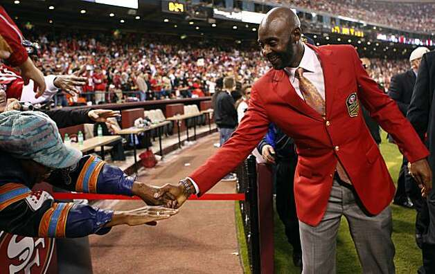 Jerry Rice shakes hands with fans during halftime of the San Francisco 49ers and New Orleans Saints game at Candlestick Park in San Francisco on Monday. Photo: Paul Chinn, The Chronicle