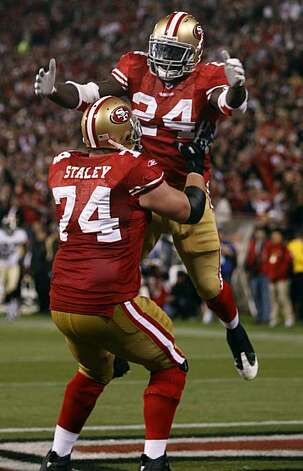 Anthony Dixon celebrates his third quarter touchdown with Joe Staley during the San Francisco 49ers and New Orleans Saints game at Candlestick Park in San Francisco on Monday. Photo: Paul Chinn, The Chronicle