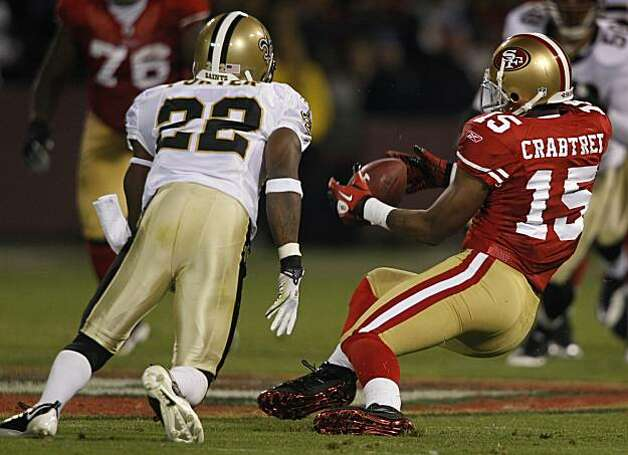 Michael Crabtree can't hang on to a pass in the fourth quarter of the San Francisco 49ers and New Orleans Saints game at Candlestick Park in San Francisco on Monday. Photo: Paul Chinn, The Chronicle