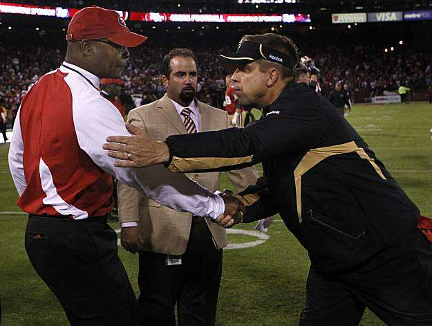 Head coaches Mike Singletary and Sean Payton meet at midfield after the San Francisco 49ers and New Orleans Saints game at Candlestick Park in San Francisco on Monday. Photo: Paul Chinn, The Chronicle