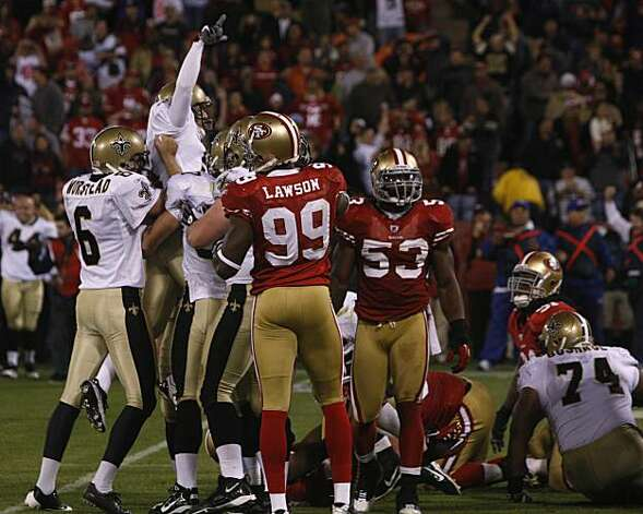 New Orleans Saints kicker Garrett Hartley and teammates celebrate the game-winning field goal over the San Francisco 49ers at Candlestick Park on Monday. Photo: Paul Chinn, The Chronicle