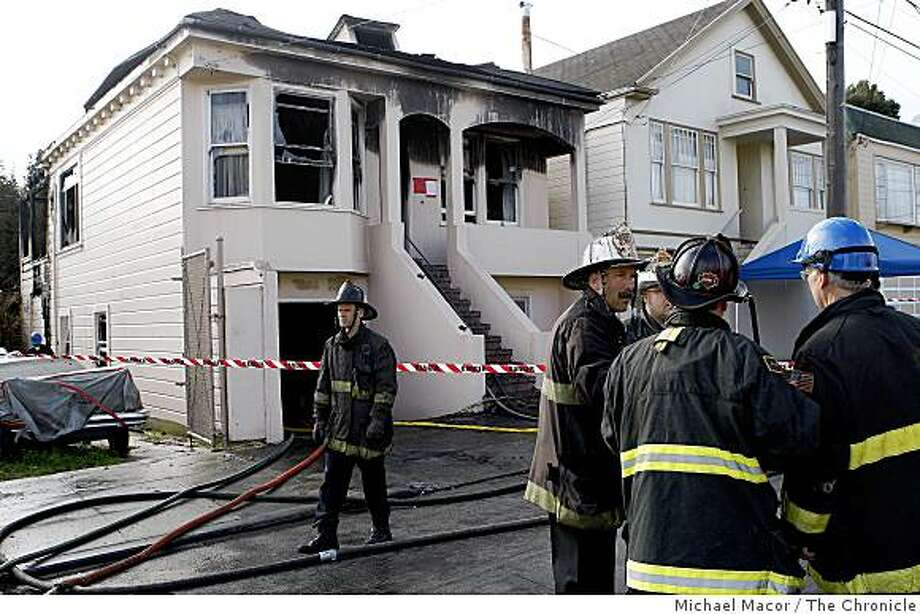 SF Firefighters gather after an early morning fire at 627 Felton St. that left one firefighter with life-threatening injuries. Photo: Michael Macor, The Chronicle