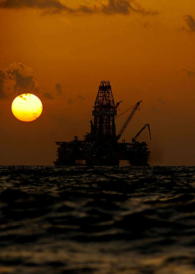 The Transocean Development Driller III leased by BP Plc is seen at sunset as it works to drill a backup relief well at the BP Plc Macondo well site in the Gulf of Mexico off the coast of Louisiana, U.S., on Thursday, July 29, 2010. BP Plc may move up the schedule for a static kill attempt, which would involve pumping mud and cement to permanently plug its leaking Macondo oil well in the Gulf of Mexico. Thursday marked the 100th day of the largest oil spill in U.S. history, which began when the Deepwater Horizon drilling rig exploded on April 20. Photographer: Derick E. Hingle/Bloomberg Photo: Derick E. Hingle, Bloomberg