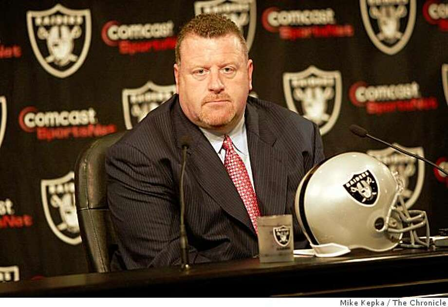 Tom Cable is announced as the New Raiders head coach by the team's owner Al Davis during a press conference at Raiders Headquarters on Wednesday Feb. 4, 2008 in Alameda, Calif. Photo: Mike Kepka, The Chronicle