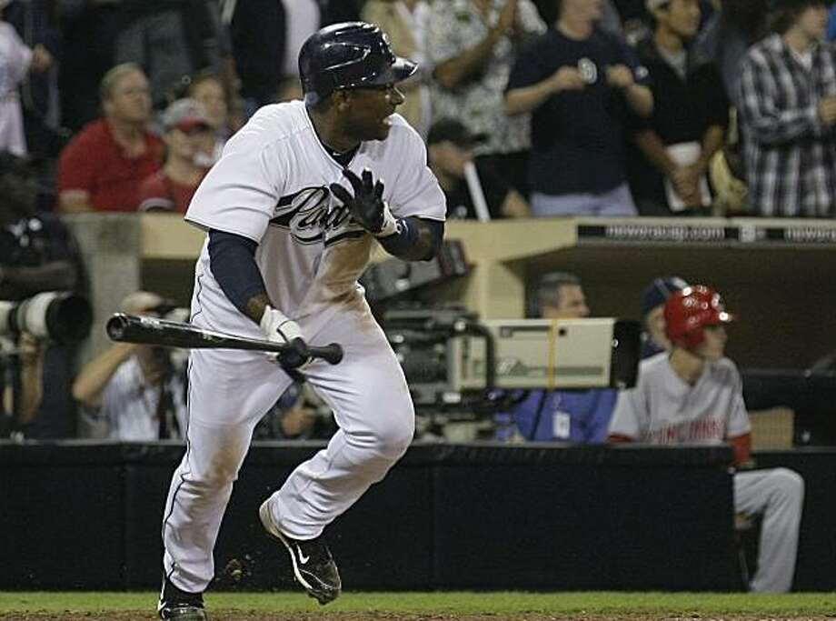 San Diego Padres' Miguel Tejada hits a single to drive in two runs against the Cincinnati Reds in the seventh inning during their baseball game Friday, Sept. 24, 2010, in San Diego. Photo: Gregory Bull, AP