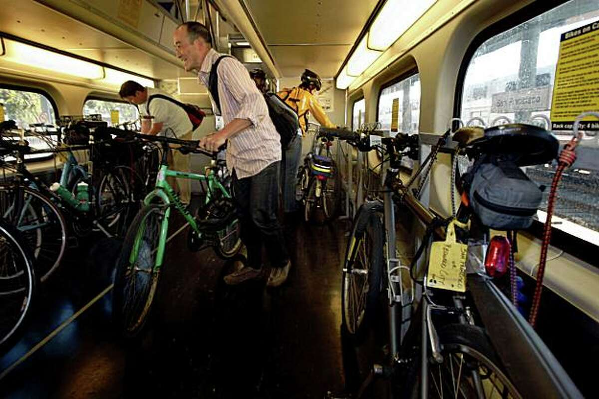 Scott Sugiura looking for a spot to park his bike on a southbound train at the Caltrain station at 4th and King in San Francisco, Calif., on Friday, September 26, 2008.
