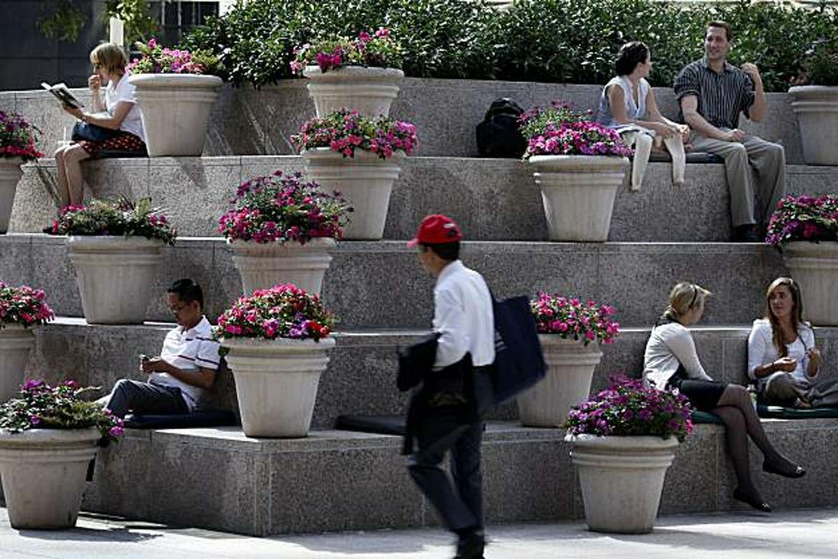 The garden plaza in front of 101 California St. provided a shady respite from the high temperatures which started the workweek. Shade was the place to be Monday as temperatures in San Francisco hovered in the 90s for much of the day.