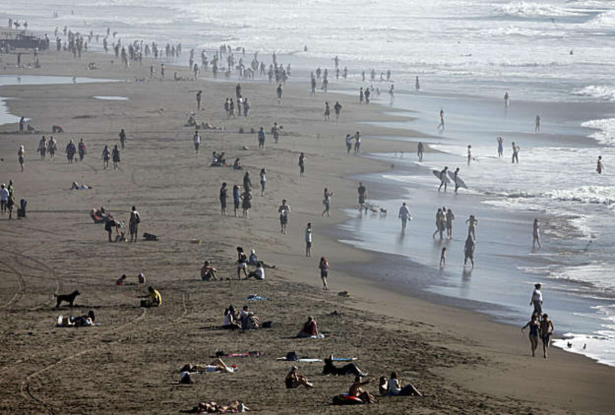 People cool off at Ocean Beach in San Francisco as temperatures hit the 90s in the downtown area Monday.