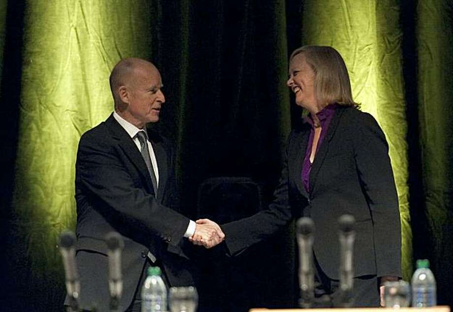 Jerry Brown and Meg Whitman greet each other at the start of a gubernatorial debate at UC Davis on Tuesday. Photo: Hector Amezcua, Via Bloomberg