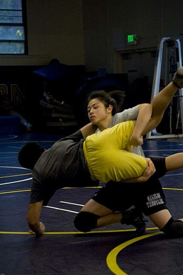 Galileo wrestler Cindy Kuang takes down an opponent in a practice bout at San Francisco State. Photo: Chester Selva