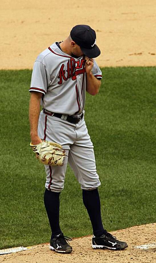 Atlanta Braves reliever Jonny Venters wipes his face after giving up a two-run single to Washington Nationals' Ian Desmond during the seventh inning of a baseball game in Washington, Sunday, Sept. 26, 2010. The Nationals beat the Braves 4-2. Photo: Ann Heisenfelt, AP