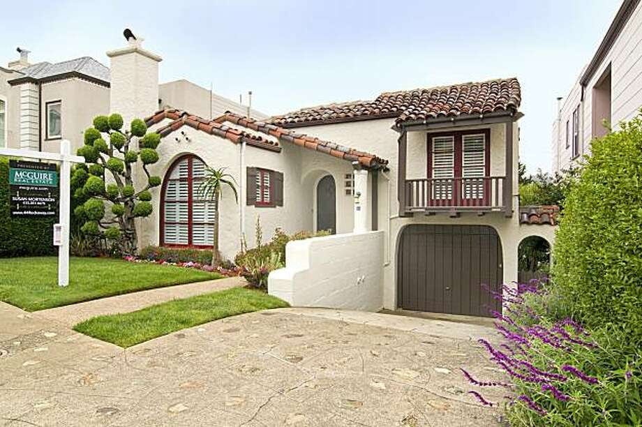 Located just west of Twin Peaks, 44 Rockaway Avenue was built in 1930 and reflects the time period in many unique details like arched doorways and wrought iron fixtures. The Mediterranean-style home includes three bedrooms and two full bathrooms; it's listed for $1.298 million. Photo: Courtesy Of Tiziana Orsini