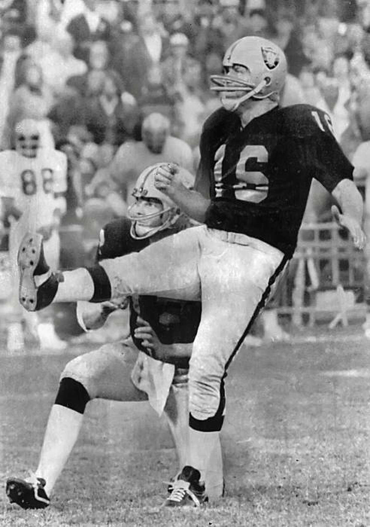 Going strong at age 48. Veteran quarterback and kicker George Blanda of the Oakland Raiders gets set to toss the ball during practice on Wednesday in Oakland, under the watchful eye of head coach John Madden. Wednesday was Blanda's 48th birthday. He's entGoing strong at age 48. Veteran quarterback and kicker George Blanda of the Oakland Raiders gets set to toss the ball during practice on Wednesday in Oakland, under the watchful eye of head coach John Madden. Wednesday was Blanda's 48th birthday. He's entering his 26th pro season and is just 81 points shy of becoming the first 2,000 point scorer in pro football history. Photo was taken September 18, 1975.Oakland Raiders' Ken Stabler and George Blanda watch intently as Blanda kicks a 36 yard field goal with two seconds remaining in the overtime quarter to give the Raiders a 37-34 win over Atlanta. Combination win over Atlanta and Kansas City's loss to Baltimore 11/30 cinched the western division title for the Raiders in the American Conference. Photo was taken December 1, 1975.