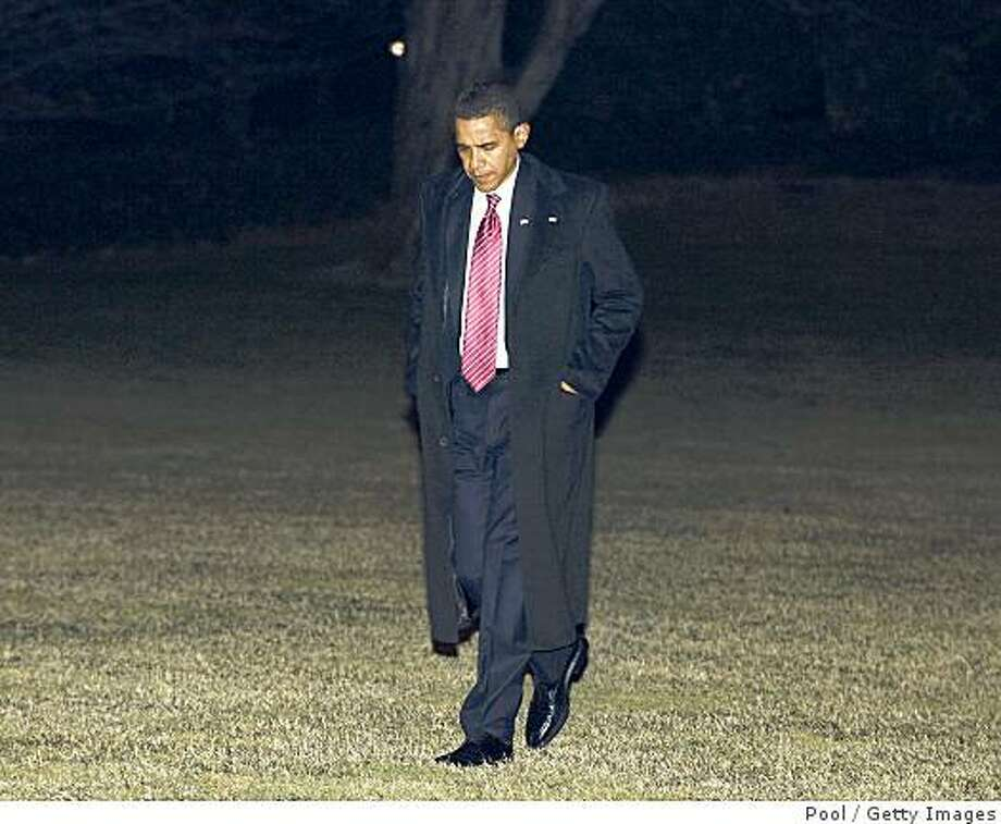 WASHINGTON - FEBRUARY 5:  President Barack Obama walks alone across the South Lawn of the White House as he returns February 5, 2009 to Washington, D.C. Obama was returing from Williamsburg, Virginia after speaking at the House Democrats Issues Conference.  (Photo by Ron Sachs-Pool/Getty Images) Photo: Pool, Getty Images