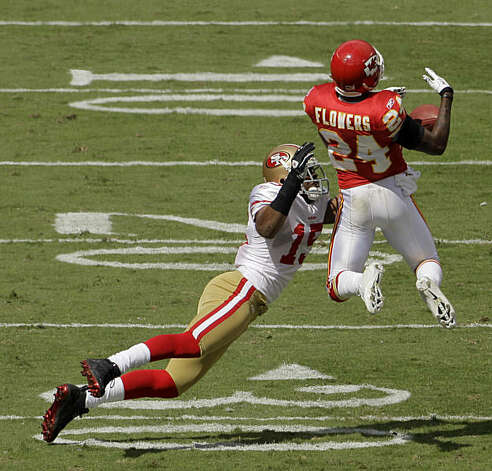 Kansas City Chiefs cornerback Brandon Flowers (24) intercepts a pass intended for San Francisco 49ers wide receiver Michael Crabtree (15) during the second quarter of an NFL football game Sunday, Sept. 26, 2010 in Kansas City, Mo. Photo: Charlie Riedel, AP