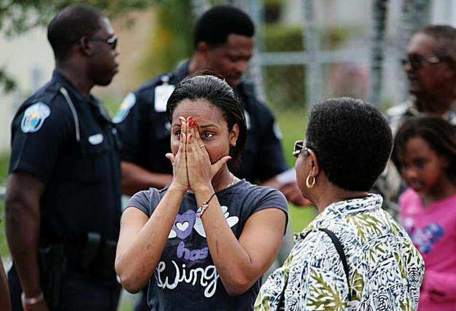 Lydia Smith, a sister-in-law to Natasha Whyte-Dell, who police say was one of five shot and killed by Patrick Dell Monday morning in Riviera Beach before taking his own life, wipes tears from her eyes outside of the residence at 1225 W. 30th St.  in Reviera Beach, Fla. Monday, Sept. 27, 2010. Photo: Brandon Kruse, AP