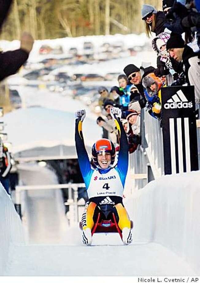 USA's Erin Hamlin reacts as she slides up the finish ramp after winning the women's Luge World Championships in Lake Placid, N.Y., Friday, Feb. 6, 2009.  (AP Photo/Observer-Dispatch, Nicole L. Cvetnic)  ** ROME (NY) OUT** Photo: Nicole L. Cvetnic, AP