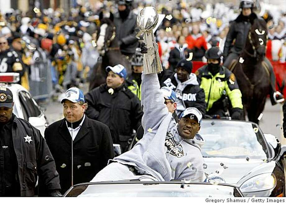PITTSBURGH - FEBRUARY 03:  James Harrison #92 of the Pittsburgh Steelers shows off the Super Bowl XLIII trophy during a parade on February 3, 2009 in Pittsburgh, Pennsylvania.  (Photo by Gregory Shamus/Getty Images) Photo: Gregory Shamus, Getty Images
